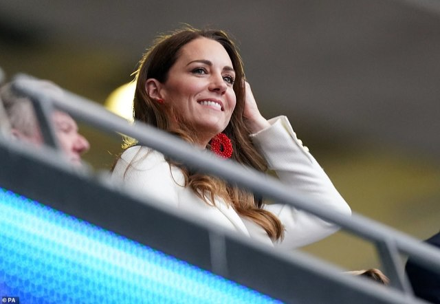 The Duchess of Cambridge wore a cream blazer with statement red earrings as she joined her husband and son at Wembley