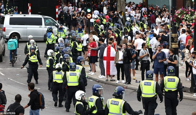 Police in helmets arrive to Trafalgar Square ahead of the match between England and Italy at Wembley tonight