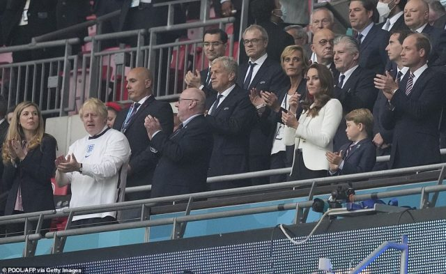The young Prince looked smart in a shirt, blazer and trousers, but reportedly wanted to wear an England jersey