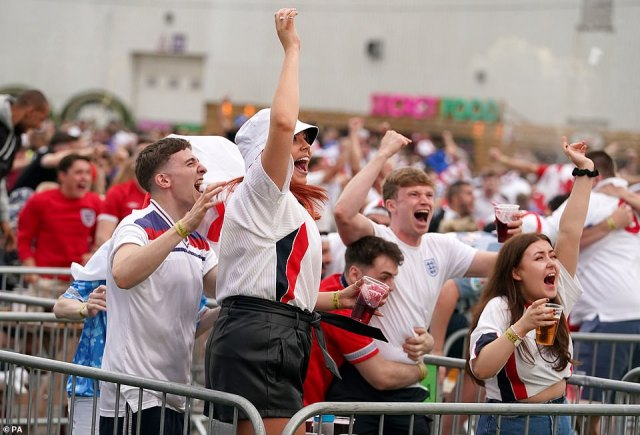 England fans in the fan zone in Trafford Park celebrate England's early goal against Italy at Wembley