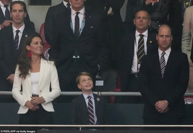 Prince George looked in awe at the scene around him as he joined Kate and William at Wembley tonight