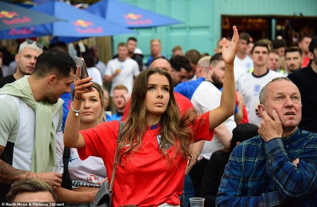 Distraught England fans can't believe what they're seeing as the Italians run riot in the second half