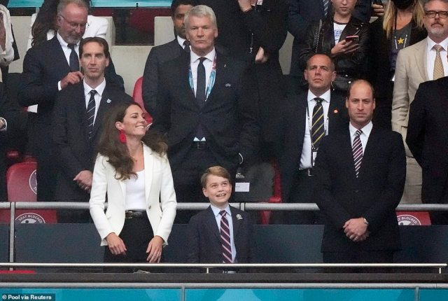 Kate Middleton gave a nod to the England strip by wearing a cream blazer and statement red earrings