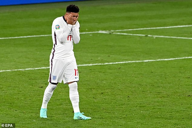 Jadon Sancho puts his head in his hands after he failed to score in the penalty shoot out in tonight's Euro 2020 final