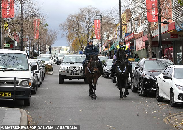 Pictured are police on horseback in the Bankstown local government area, where ramped-up police patrols have been enforcing Sydney's Covid-19 lockdown