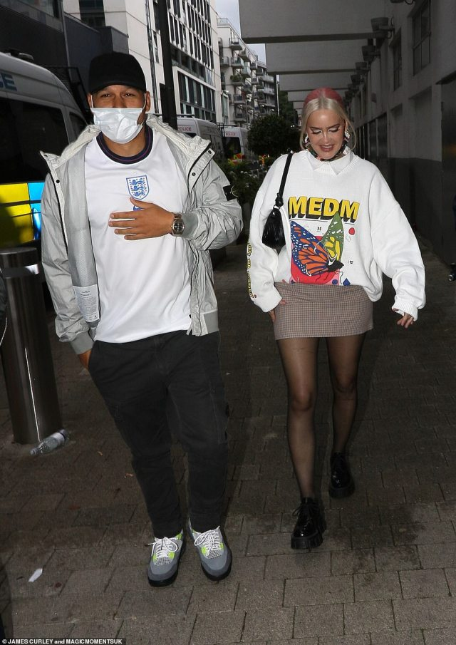 Style savvy: An edgy looking Anne-Marie was later seen arriving to Wembley with a male friend clad in an England shirt