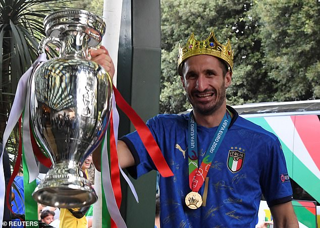 Italy skipperChiellini with the European Championship trophy as the winners arrive in Rome