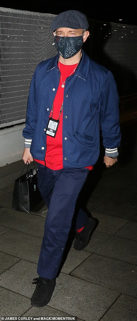 Going home:Martin Freeman was sporting a flat cap and holding a gift bag