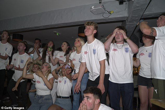 Fans watch the penalty shootout during the Euro 2020 final between Italy and England at Fistral Beach Bar in Newquay last night