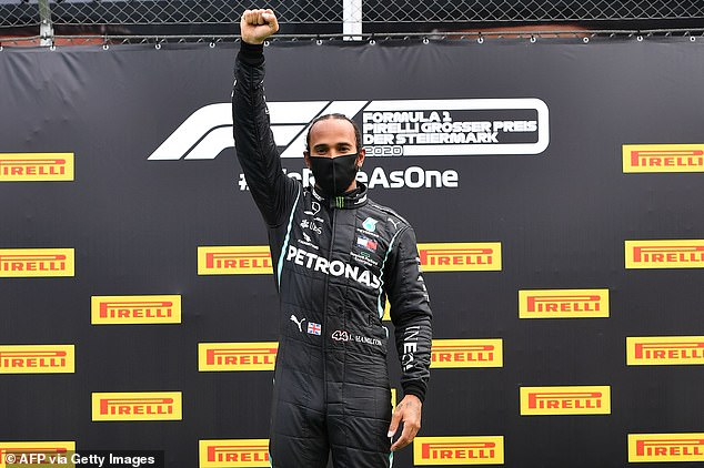 Activism: The seven-time F1 champion also raised a fist for Black Power at last year'sStyrian Grand Prix