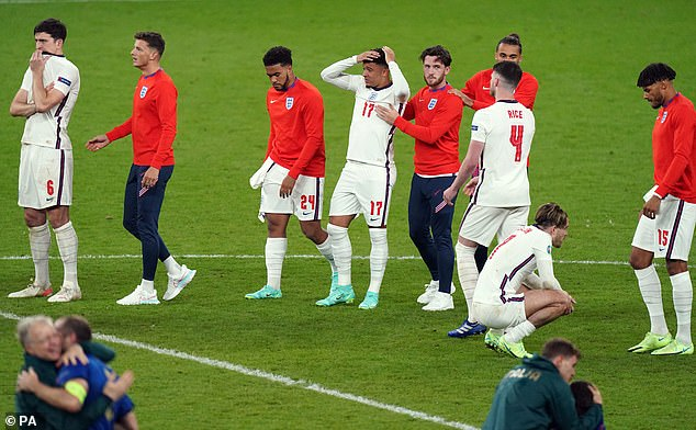 England's Jadon Sancho (centre) stands dejected at the end of the game after missing from the penalty spot during the shootout following the Euro 2020 Final at Wembley Stadium last night