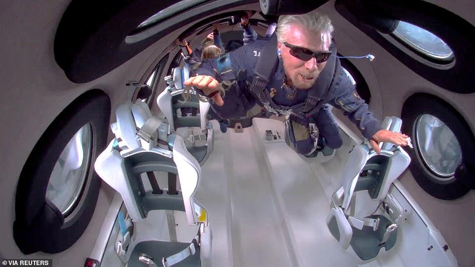 In this shot, Branson floats in zero gravity on board Virgin Galactic's passenger rocket plane VSS Unity during the short flight