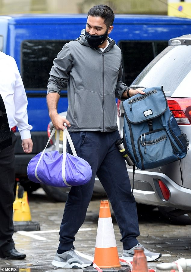 Keeping it casual: The actor arrived wearing his own casual clothing, with his face mask having slipped beneath his nose