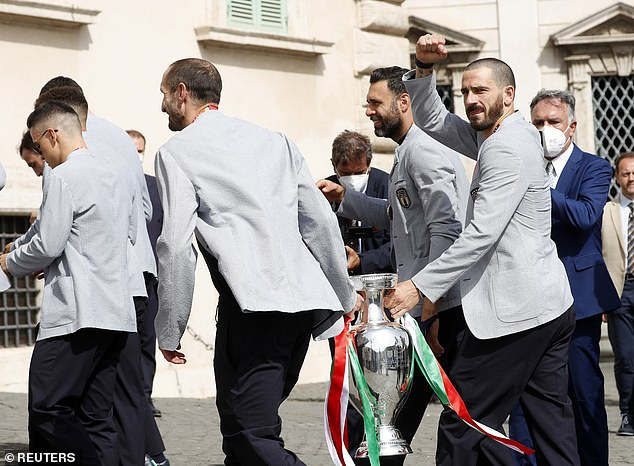 Leonardo Bonucci, who scored at Wembley, waves to the Italy supporters greeting the team