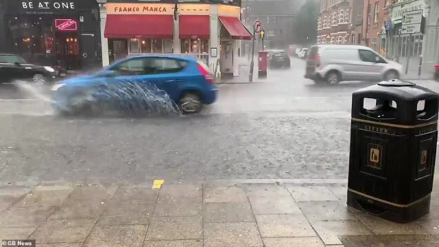 The Met Office issue a yellow weather warning as west London is battered with downpours of rain and thunderstorms