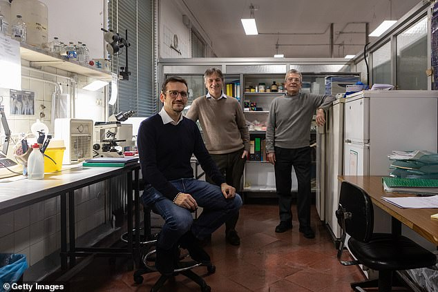 A World Health Organization-led team studying the origins of Covid-19 have turned their attention to the case of a 25-year-old Italian woman whose identity is unknown. Pictured L-R:Researchers Giovanni Fellegara, Raffaele Gianotti and Massimo Barberis