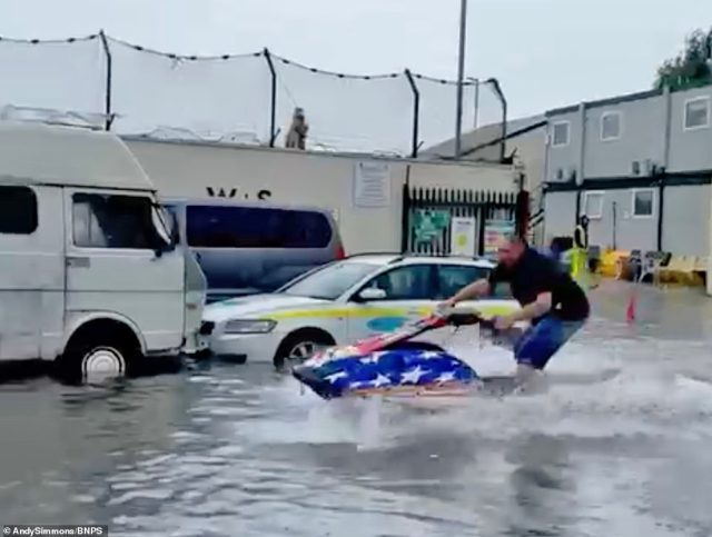 It wasn't all mayhem, as mechanic Andy Simmons downed tools and brought out the jet-ski he stores at his garage in Poole, Dorset