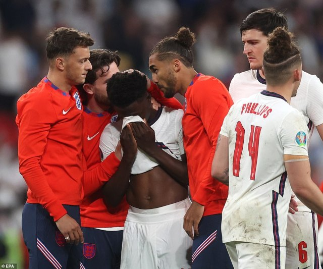 Nineteen-year-old Bukayo Saka is inconsolable after failing to score his penalty kick and handing victory to the Italians