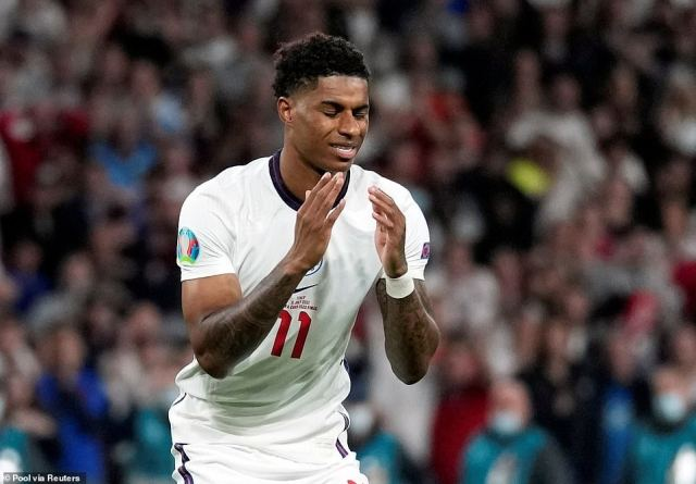 Marcus Rashford today said he was 'close to tears' after well-wishers covered graffiti sprayed on his Manchester mural with notes of support in the wake of his Euro 2020 penalty heartache