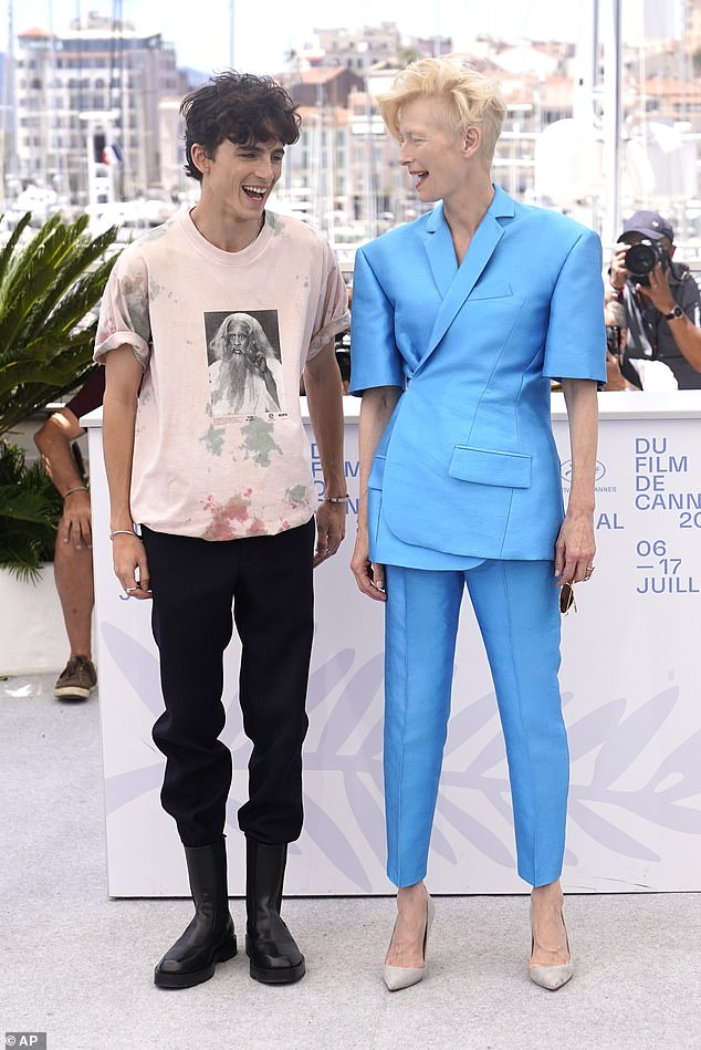 Co-stars:Timothée Chalamet, 25, and Tilda Swinton, 60, appeared in good spirits as they attended a photocall for The French Dispatch at the Cannes Film Festival in France on Tuesday