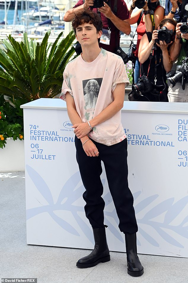 Casual: Timothée opted for a laid back look for the event, sporting a printed off-white T-shirt which he wore with black trousers tucked into matching boots