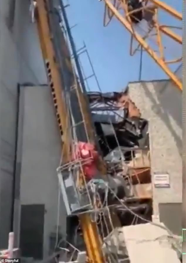 As the crane fell, it hit an adjacent building and the roof of an 'old-age home'