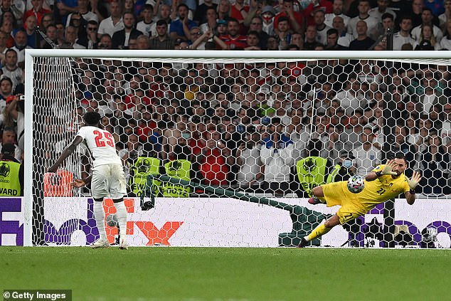 Saka fired his penalty to Gianluigi Donnarumma's left, but the giant Italy keeper parried it away