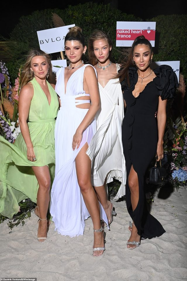 Looking good: Julianne, pictured with Alisa Volskaya, Sasha Luss and Tamara Kalinic, flashed a glimpse of cleavage in the low-cut dress which pulled together at the waist with a cinching waistband