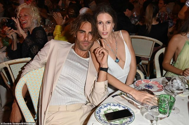 Hunk: Spanish model and actor Jon Kortajarena, 36, showed he has a way with the ladies as he cosied up to several women at the event on Tuesday wearing pasting pink suit