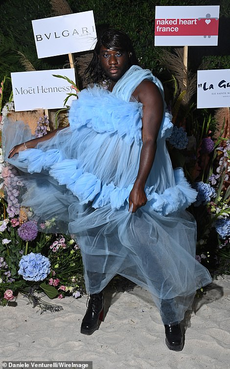 Glam: Fashion commentator Louis Pisano also went for a blue gown for the event, posing up a storm in the lacy frilled look and adding a pair of chunky black boots