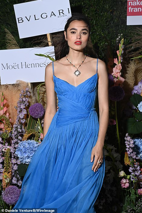 Sexy: Model and artist Solange Smith, 24, wore an exquisite electric blue strappy dress which pulled her in at the waist and complemented her contrasting red lipstick