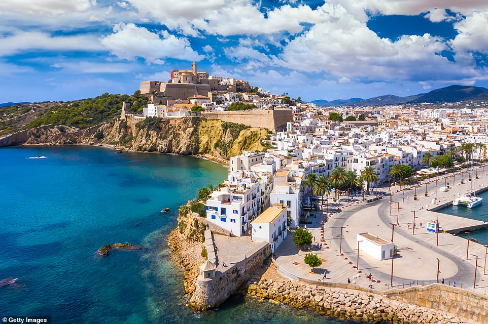 The Balearic islands, including Ibiza (pictured), look doomed to be moved to higher restrictions only a fortnight after being approved for quarantine-free travel, with a decision possible as early as today
