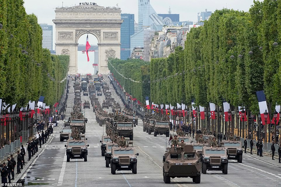 France celebrated its national holiday with thousands of troops marching down Champs-Elysees in Paris on Wednesday