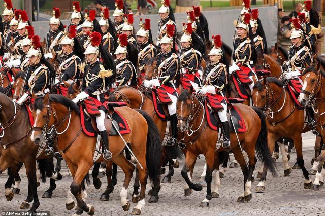 Republican Guard cavalry officers march during the annual Bastille Day military parade