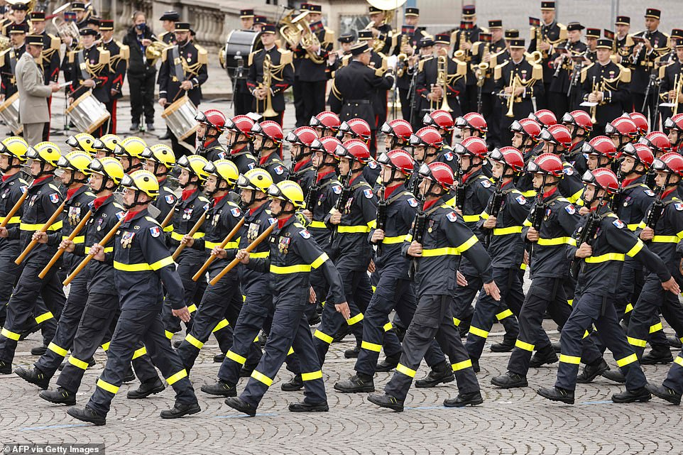 Members of the French Civil Defence (Securite Civile) march during the annual Bastille Day military parade