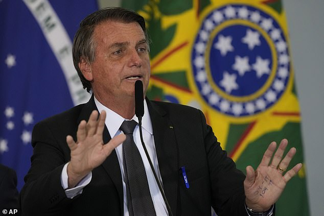 Brazil's President Jair Bolsonaro (pictured, speaking during a ceremony in Brasilia on Tuesday) was admitted to hospital on Wednesday with hiccups that have lasted for days