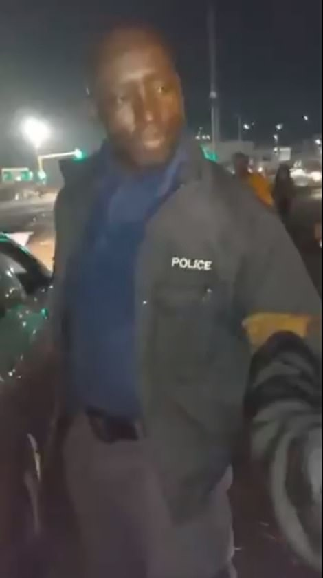 Footage showed people accosting a man wearing a police jacket beside a hatchback filled with household supplies, including bread, milk and cooking oil