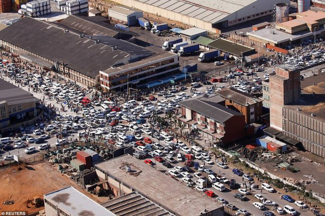 A traffic jam surrounds warehouses in Durban targeted by looters on Wednesday