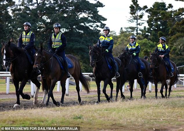 Police officers are pictured on horseback in Sydney's Centennial Park on Thursday morning