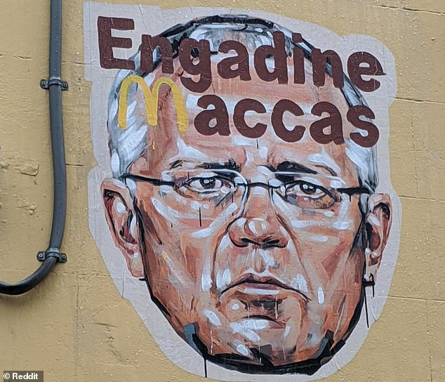 Scott Marsh - an artist known for his often political street murals - painted a picture of a concerned looking Mr Morrison with the words 'Engadine McDonalds' printed in brown above his head
