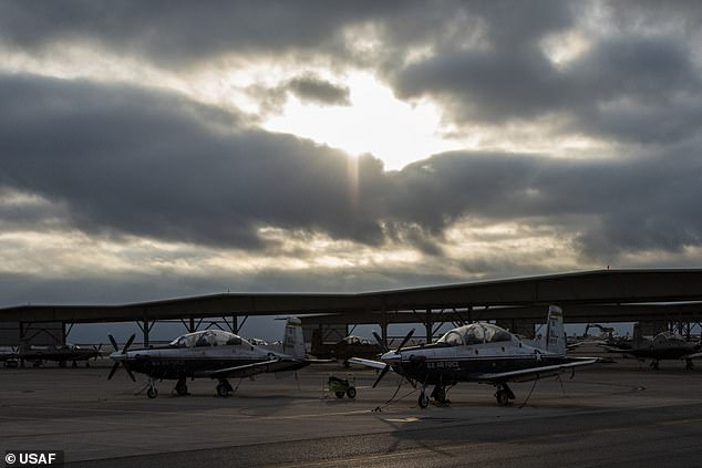Military planes are seen at Laughlin air force base in Texas. ICE are using the air force base to transport, on passenger planes, migrants across the country
