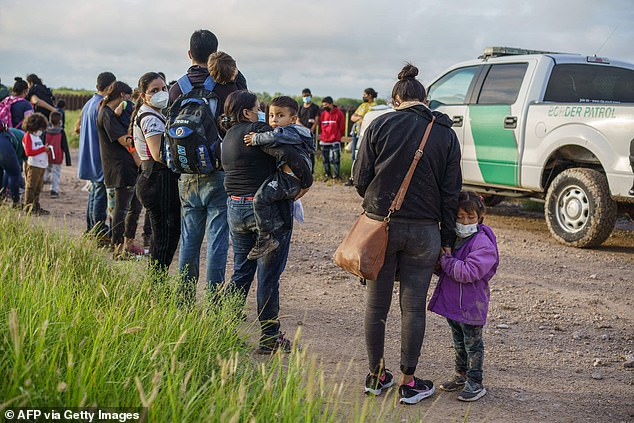 Migrants are seen in Penitas, Texas, on July 8 waiting to be processed by Border Patrol