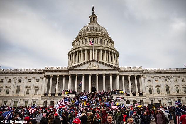 Milley reportedly referred to Trump supporters as 'brownshirts' and compared the former president to Hitler. The image above shows Trump supporters rioting at the US Capitol on January 6