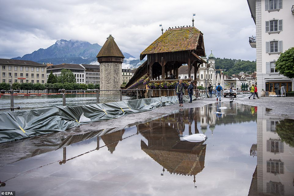 The first water overflows at the Reuss River in Lucerne, Switzerland, on Thursday