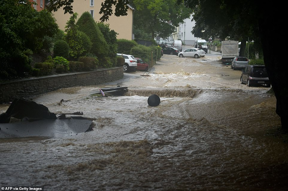 Streets were turned into rivers that ripped up roads with the city of Hagen, south of Dortmund, particularly hard-hit (pictured)