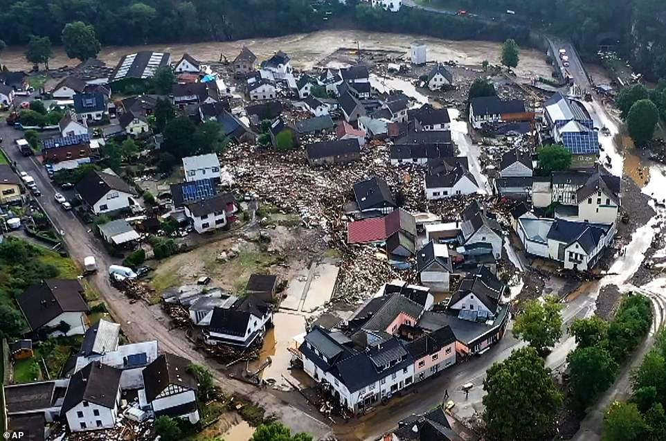 GERMANY: The village ofSchuld (pictured) was partially destroyed by flooding overnight that swept away six homes killing at least four people - though dozens more have been reported missing