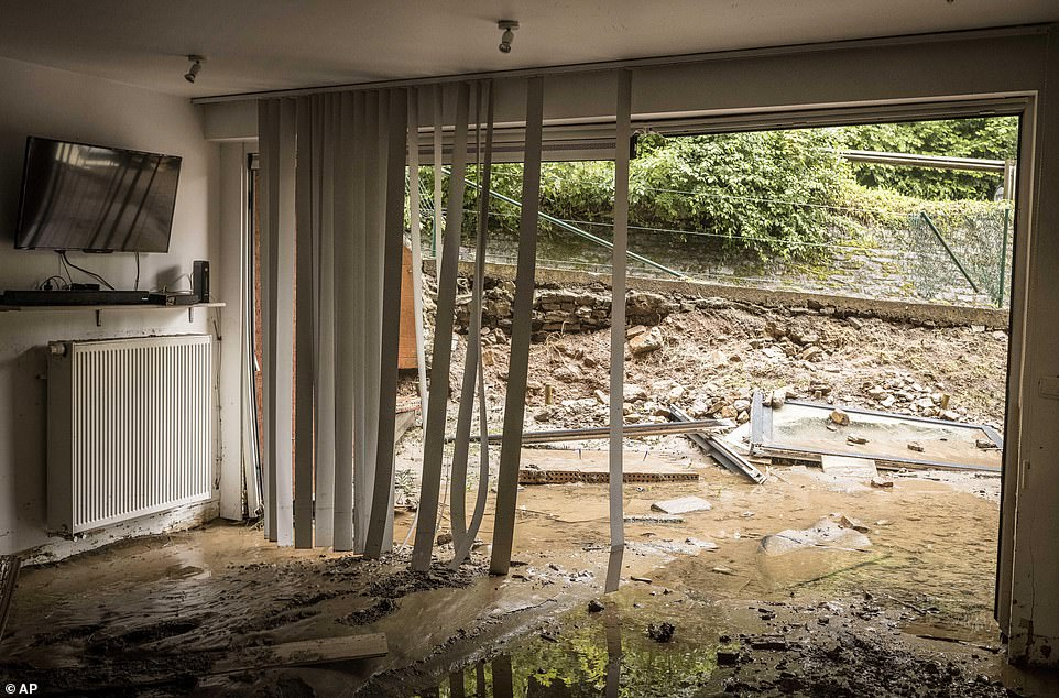Mud and water fill the ground floor of a house flooded by rainwater in Mery, Province of Liege, Belgium