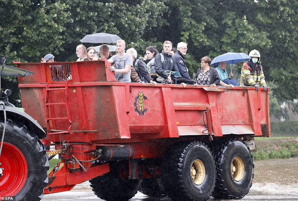 NETHERLANDS:The fire brigade evacuate people from their homes in South Limburg, the Netherlands, after towns were flooded amid torrential rain
