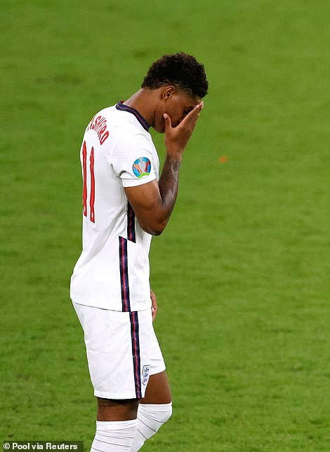 Rashford reacts after his penalty miss in England's shoot-out defeat by Italy
