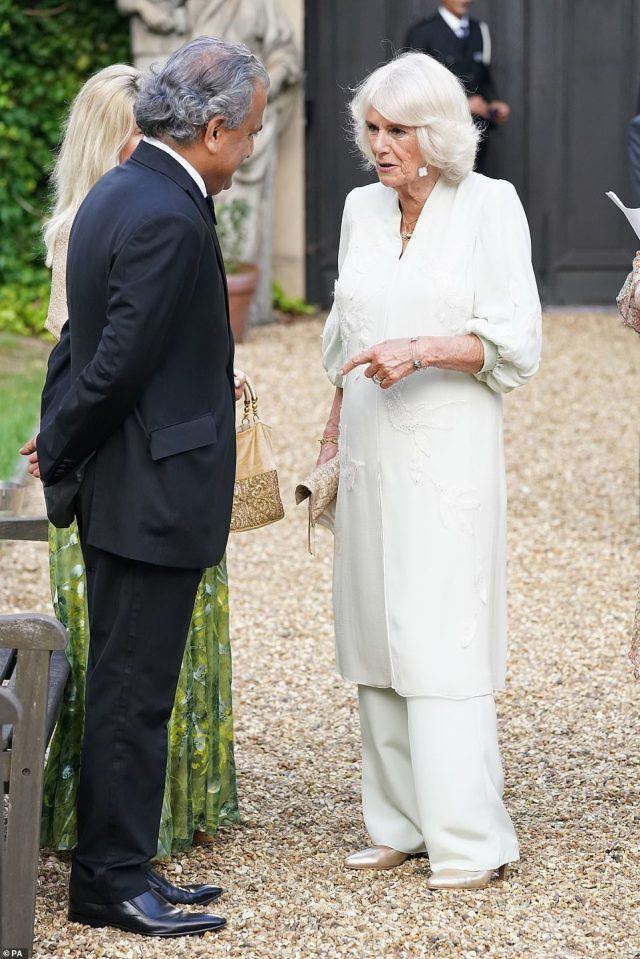 The Duchess of Cornwall (pictured right) looked chic in her ensemble, and accessorised with a woven clutch bag, drop earrings and gold court heels
